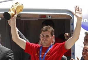 Spain's captain Iker Casillas lifts the World Cup trophy after arriving at Madrid's Barajas airport