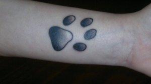 L'importa della sua zampa che mi sono tatuata due anni fa